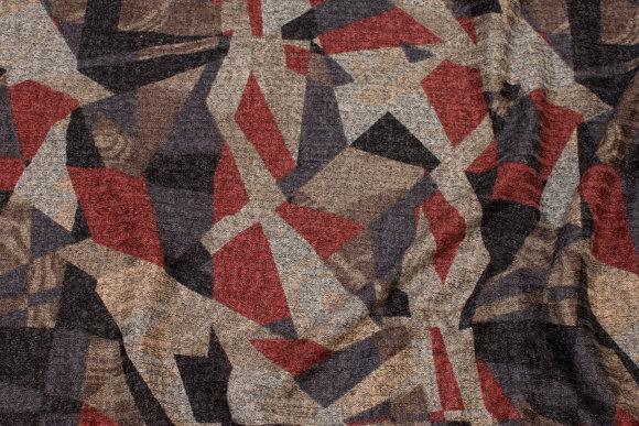 Let vinterstrik med grafisk mønster i sort og bordeaux