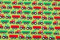 Lysegrøn bomuldsjersey med traktorer.