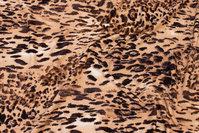 Viscosejersey med dyreprint i gyldne farver