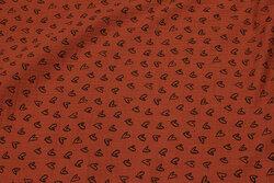 Dobbelvævet bomuld (gauze) i rustfarvet med små sorte hjerter