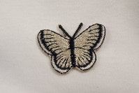 Lille sommerfugl 2x3cm