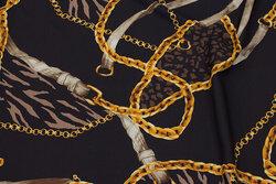 Mat sort micro-polyester med stræk og gyldent kædemønster