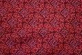 Patchworkbomuld med fint mønster i hindbærfarver