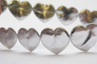 Sølv hjerter el. stjerner på bånd 1,6cm